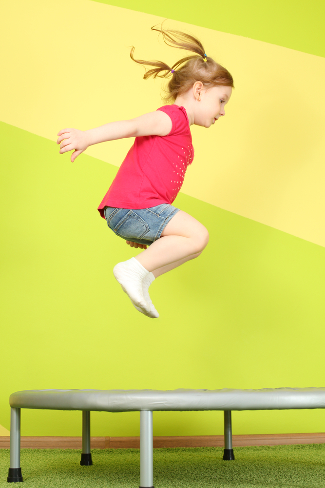 Okanagan Vision Therapy - Little girl jumping on trampoline