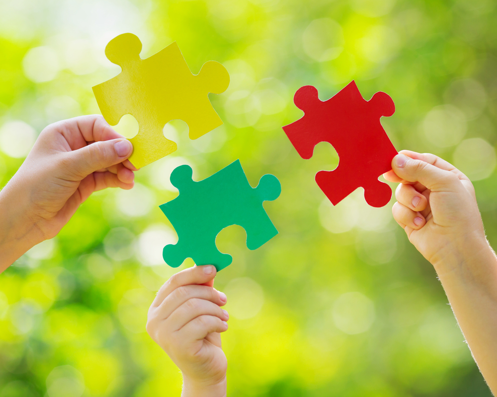 Okanagan Vision Therapy - Colourful puzzle pieces - symbol of autism